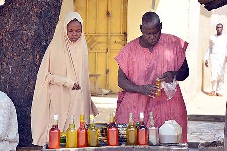 Trader at kano,nigeria selling palm-oil.jpg