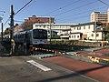 Train for Fukuma Station near Kyushu Sangyo University.jpg