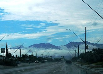 Monsoon clouds blanket the Catalina Mountains in August 2005. Tucsonmonsoon.jpg