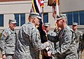 U.S. Army Gen. David M. Rodriguez, right, passes the U.S. Army Forces Command (FORSCOM) colors to Gen. Raymond T. Odierno, center, the chief of staff of the Army during the change of command ceremony at Fort 130315-A-NT965-781.jpg