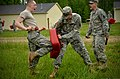 U.S. Army Pvt. Jerod Wood, left foreground, with Headquarters and Headquarters Company, 105th Military Police Battalion, North Carolina Army National Guard, makes his way through a defense course during 130501-Z-AY498-003.jpg