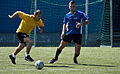 U.S. Army Sgt. Jeffery Hernandez, left, with American Forces Network Europe, competes in a soccer game against the Latvian navy soccer team June 9, 2013, during Baltic Operations (BALTOPS) 2013 at Parventa 130609-N-ZL691-092.jpg