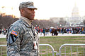 U.S. Army Spc. Brion Carrion, with the Delaware Army National Guard, directs spectators during the presidential inauguration in Washington, D.C 130121-Z-JM126-003.jpg