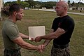 U.S. Marine Corps Maj. Robert B. Thomas, right, presents a certificate to a graduate of the Marine Corps Martial Arts Program instructor course at U.S. Naval Computer and Telecommunications Station Guam 130405-M-LN208-010.jpg