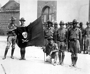 United States occupation of Nicaragua - United States Marines with the captured flag of Augusto César Sandino in 1932