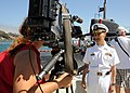 U.S. Navy Cmdr. Chris Cavanaugh, the commanding officer of the Los Angeles-class attack submarine USS Albuquerque (SSN 706), answers questions during an interview with local media following a seven-month 130821-N-NB544-218.jpg