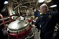 U.S. Navy Ensign Matthew Clark, left, and Chief Warrant Officer 3 Tony Daneault inspect spaces in the main engine room aboard the guided missile cruiser USS Gettysburg (CG 64) in the Gulf of Oman Dec. 16, 2013 131216-N-PL185-054.jpg