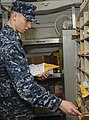 U.S. Navy Logistics Specialist 2nd Class David D. Pollard sorts mail aboard the aircraft carrier USS Nimitz (CVN 68) 130130-N-BJ752-070.jpg