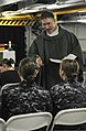 U.S. Navy Lt. Andrew Colvin, a chaplain, speaks with midshipmen while celebrating Catholic Mass aboard the aircraft carrier USS Nimitz (CVN 68) June 23, 2013, in the Gulf of Oman 130623-N-FV746-012.jpg
