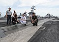 U.S. Navy Rear Adm. Michael S. White, the commander of Carrier Strike Group (CSG) 11, gives a tour of the flight deck to Thai military members and nationals aboard the aircraft carrier USS Nimitz (CVN 68)in 130529-N-BJ752-052.jpg