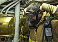 U.S. Navy Religious Program Specialist 3rd Class Bryant Fossier dons a self-contained breathing apparatus face mask during a general quarters drill March 30, 2013, aboard the amphibious dock landing ship USS 130330-N-IY633-029.jpg