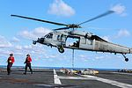 U.S. Sailors attach ordnance to an MH-60S Seahawk helicopter attached to Helicopter Sea Combat Squadron (HSC) 22 on the flight deck of the aircraft carrier USS Dwight D. Eisenhower (CVN 69) in the Atlantic Ocean 130807-N-YO152-006.jpg