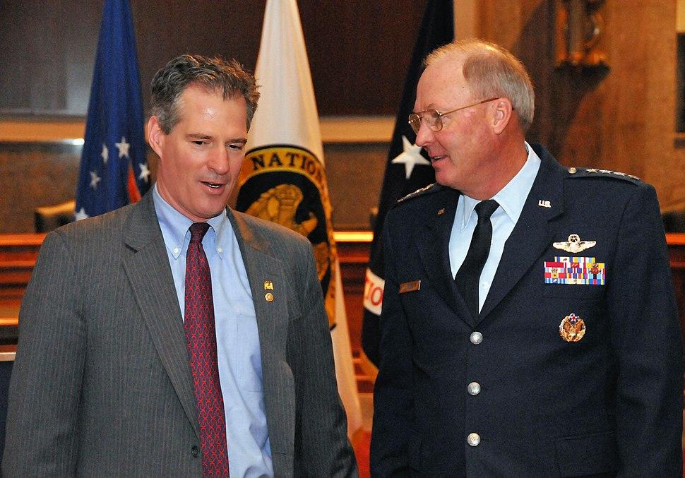 U.S. Senator Scott Brown speaking with Chief of the National Guard Bureau General Craig R. McKinley at the Senate National Guard Caucus breakfast in 2011