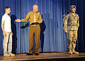 U.S. Soldiers perform an reenactment of Audie Murphy military biography, on stage, during an induction ceremony, at Sergeant Audie Murphy Club, at Fort Gordon, Ga. 091202-A-NF756-002.jpg