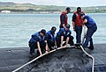 U.S Sailors assigned to the attack submarine USS Chicago (SSN 721) secure mooring lines as the Chicago returns to Apra Harbor, Guam, April 25, 2013 after completing its first mission as part of Commander 130425-N-LS794-133.jpg