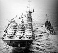 USS Philippine Sea (CVS-47) refuels the destroyer USS Orleck (DD-886) in the Pacific Ocean, in May 1957 (NNAM.1996.488.114.056).jpg