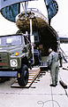 US Navy 021213-N-7677N-009 Seabees back a 25-ton tractor-trailer onto a U.S. Air Force C-5.jpg