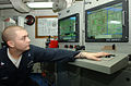 US Navy 030220-N-4655M-004 Engineman 3rd Class Waylon Henke makes adjustments to the electric plant aboard the guided missile cruiser.jpg