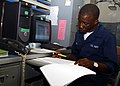 US Navy 030407-N-7672K-003 Personnelman Seaman Abiodun Asha from Staten Island, N.Y., works diligently at his trade making sure the crews' personnel records are accurate and up to date.jpg