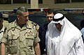 US Navy 030417-N-5362A-002 Gen. Tommy Franks, Commander, U.S. Forces Central Command (CENTCOM) and Lt General (retired) Ali Al-Mumin, head of Kuwait's Humanitarian Operations Center.jpg