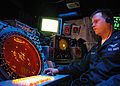 US Navy 040610-N-1512S-041 Air Traffic Controller 2nd Class Jack Coleman, from Detroit, Mich., stands watch in the Helicopter Direction Center.jpg