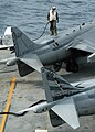 US Navy 040712-N-0938S-004 Marine Corps Sgt. Adam Alewine, assigned to the Bulldogs of Marine Attack Squadron Two Two Three (VMA-223), stands on the wing of an AV-8B Harrier II while preparing to inject demineralized water into.jpg