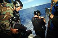 US Navy 040721-N-4308O-019 Photographer's Mate 1st Class Jody Landham, left, assists Lt. Ben Cipperley, and Lt. Commander Dave Givey assigned to Explosive Ordnance Disposal Mobile Unit Six (EOD MU-6) deploy from a Seahawk helico.jpg