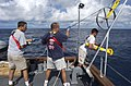 US Navy 040827-N-7676W-145 Staff archeologist Frank Cantelas, left, and crew aboard the Office of Naval Research (ONR) vessel YP-679, Afloat Lab, retrieves the Towfish side scan sonar unit at the end of the day.jpg