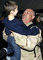 US Navy 050122-N-4048T-009 Electronics Technician 1st Class Steven Lucas, of St. Clair, Mich., is welcomed home by his son on board Naval Station Norfolk, Va.jpg