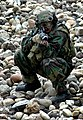 US Navy 050422-N-1722M-110 Equipment Operator 2nd Class Gary Tyler assigned to Naval Mobile Construction Battalion Three (NMCB-3) based at Port Hueneme, Calif., provides cover on San Antonio Dam.jpg