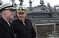 US Navy 050701-N-9851B-018 Commanding Officer, USS Curtis Wilber (DDG 54), Cmdr. John T. Lauer III, right, speaks with Lt.j.g. Justin Guiterman as they wait for the brow to be attached to the ship.jpg