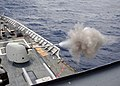 US Navy 050719-N-4374S-004 The guided missile cruiser USS Thomas S. Gates (CG 51) fires a training round from an MK-45 5-inch-54 caliber lightweight gun during a live fire exercise in the Caribbean Sea.jpg