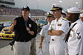 US Navy 050909-N-2820Z-001 Sailors watch and listen as Fitz-Bradshaw racing David Walker explains the racing business on Pit Road at the Richmond Speedway.jpg