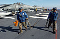 US Navy 051114-N-9866B-184 Aviation Boatswain's Mates assigned to Air Department remove the chains from a U.S. Marine Corps AV-8B Harrier.jpg