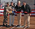 US Navy 051129-N-1577S-021 Navy personnel cut the ribbon for a newly renovated softball field on board Fleet Anti-Submarine Warfare Base.jpg