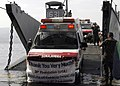 US Navy 061018-M-7843R-264 A U.S. Sailor from USS Harpers Ferry (LSD 49) gives the thumbs up during the loading of five Ford F350 ambulances onto a landing craft utility at Subic Bay Freeport.jpg