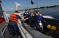 US Navy 070329-N-1810F-043 Boatswain's Mate 1st Class Matthew Masingill from Naval Station Mayport Harbor Operations congratulates the rigid hull inflatable boat (RHIB) team from USS Dewert (FFG 45) on an excellent perfo.jpg
