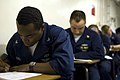 US Navy 070701-N-9864S-001 Personnel Specialist 3rd Class Darryl Mitchell, from Dallas, takes a College Level Examination Program (CLEP) test on USS Kitty Hawk (CV 63).jpg