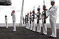 US Navy 070918-N-3143M-023 Sailors present arms after performing a gun salute during a burial at sea on board Nimitz-class aircraft carrier USS Harry S. Truman (CVN 75) for two former Sailors.jpg
