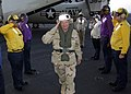 US Navy 071029-N-6524M-012 Chief of Naval Operations (CNO) Adm. Gary Roughhead salutes as he passes through the rainbow sideboys.jpg