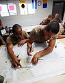 US Navy 080729-N-6552M-090 Basic crewman training (BCT) students lay out navigational tracks on a chart.jpg