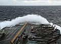 US Navy 081004-N-9299W-001 Large waves create sea spray over the bow of the amphibious assault ship USS Peleliu (LHA 5). Peleliu is deployed to the Navy's 7th Fleet area of responsibility.jpg