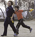 US Navy 090207-N-8546L-441 Operations Specialist 2nd Class Iesja Aldridge plays tag with a child from the Myojoo-en Children's Home.jpg