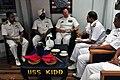 US Navy 090515-N-1488S-079 Commanding Officer, USS Kidd (DDG 100), Cmdr. Chuck Good, shares a cup of tea with Flag Officer Eastern Fleet, Indian Navy, Rear Adm. A.G. Thapliyal, during the International Maritime Defense Exhibiti.jpg