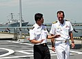 US Navy 090608-N-8467B-026 Commodore William A. Kearns III, right, Commander, Task Group 73.5, visits with Col. Wellman Wan, Commander, First Flotilla, Republic of Singapore Navy, aboard the Republic of Singapore Navy frigate R.jpg