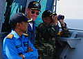 US Navy 090628-N-5207L-154 Royal Malaysian Navy Capt. Halim Bin Maulud, Commodore William Kearns III, Commander, Task Group 73.5, and Malaysian Army Col. Stephen Mundaw watch a surface gunnery exercise from the bridge wing of U.jpg
