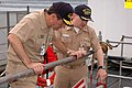 US Navy 090806-N-8119A-012 Cmdr. James Crosley, right, commanding officer of the ballistic missile submarine USS Alabama (SSBN 731), gives Vice Adm. John Donnelly, commander, Submarine Force, a tour of Alabama.jpg