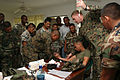 US Navy 091201-M-6217B-677 Sailors and Marines how members of the Belize Defense Force how to administer Intravenous therapy.jpg