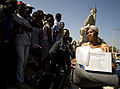 US Navy 100125-N-6266K-177 A Haitian earthquake survivor leaves a local Red Cross distribution site after receiving non-perishable items in Port-au-Prince.jpg
