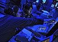 US Navy 100327-N-4774B-421 Sonar Technician Surface 1st Class Nicole Ogir assists Operations Specialist 1st Class Cassandra Karo during watch aboard USS Bunker Hill (CG 52).jpg